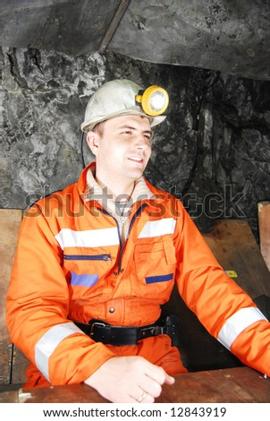 Smiling miner in a mine shaft having a break stock photo