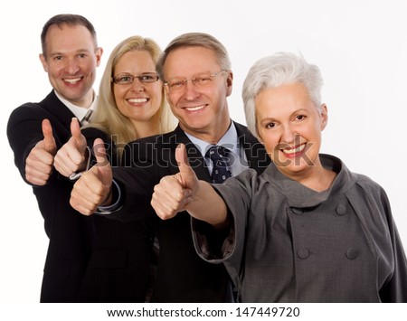 Smiling mixed business team showing thumb up isolated on white background - stock photo