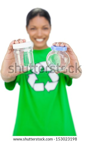 Smiling model wearing recycling tshirt holding pots on white background