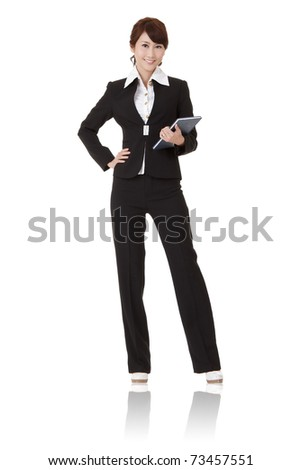 Smiling modern business woman of Asian holding book and looking at you, full length portrait isolated on white background.