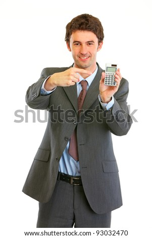Smiling modern businessman pointing finger on calculator