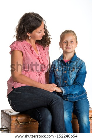 Smiling mother and daughter on a white background