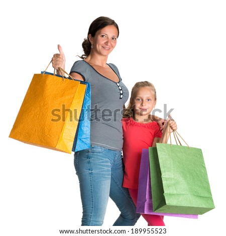 Smiling mother and daughter with shopping bags on a white background