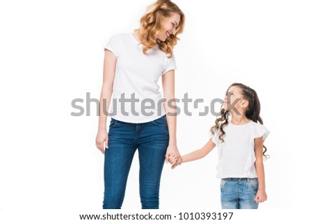 smiling mother and little daughter holding hands isolated on white