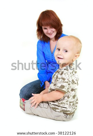 smiling mother and son over white