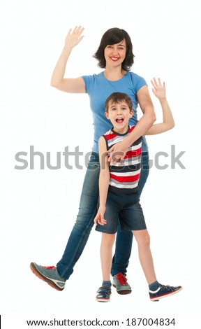 Smiling mother and son waving hands isolated on white