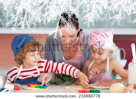 Smiling mother baking with her children against frost - stock photo