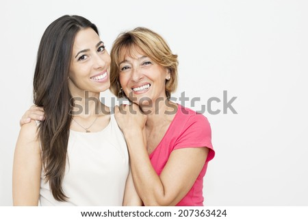 Smiling mother embracing her beautiful  daughter.  - stock photo