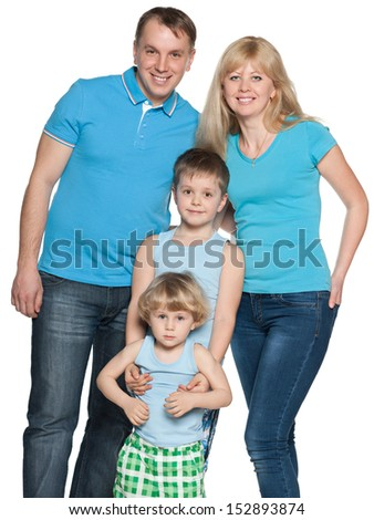 Smiling mother, father and two sons are standing together on the white background - stock photo