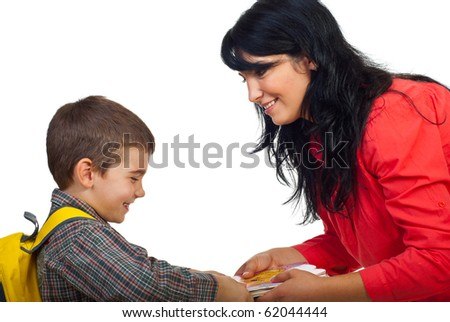 Smiling mother giving books to her son and the boy  laughing and take the books and preparing for school isolated on white background - stock photo