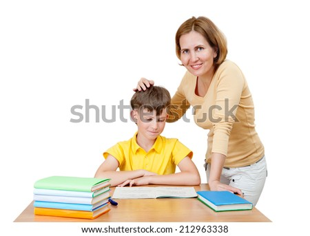 smiling mother praises schoolboy - stock photo