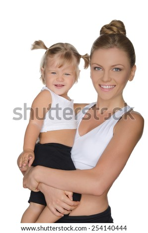 Smiling mother with her daughter in clothes for fitness isolated on white - stock photo