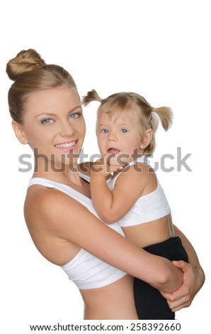 Smiling mother with her daughter in clothes for sport isolated on white - stock photo
