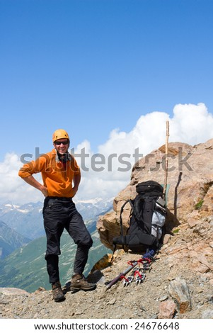 Smiling mountain-climber on the rock