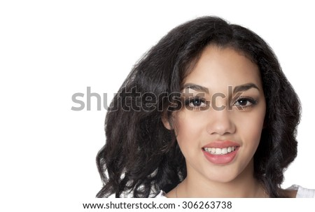 Smiling mulatto woman on a white background