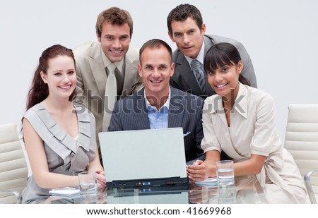 Smiling multi-ethnic business team working together in an office