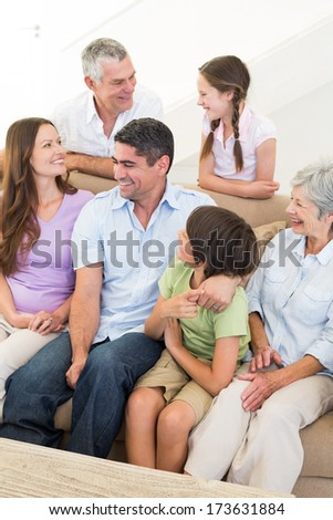 Smiling multigeneration family at home - stock photo