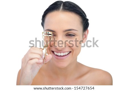 Smiling natural model with eyelash curler on white background