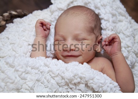 Smiling newborn baby - stock photo