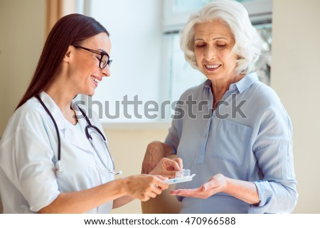 Smiling nurse with her patient