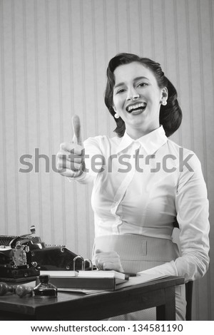 Smiling office worker showing thumb up - stock photo