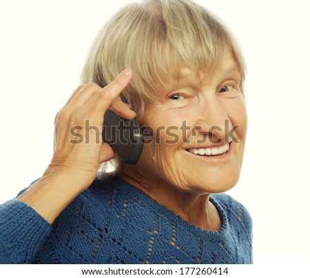 Smiling old lady communicating through mobile phone  - stock photo