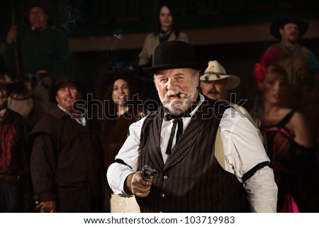 Smiling old west bad guy with cigar and revolver