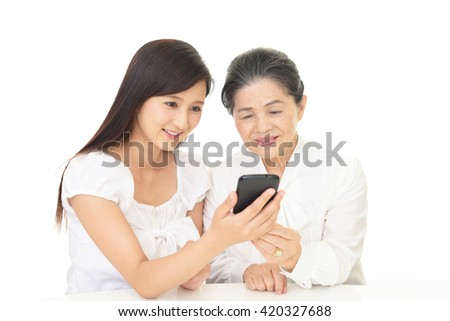 Smiling old woman and young lady
