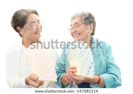 Smiling old women - stock photo