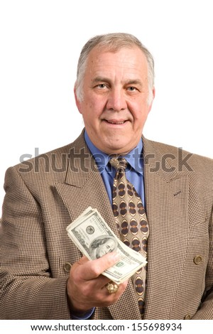 Smiling older businessman in a sports coat and tie over a white background holding fist full of dollar bills - stock photo