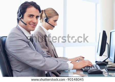 Smiling operators using a computer in a call center