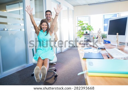 Smiling partners having fun in the office - stock photo