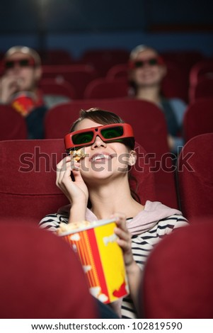 Smiling people a the 3D cinema - stock photo