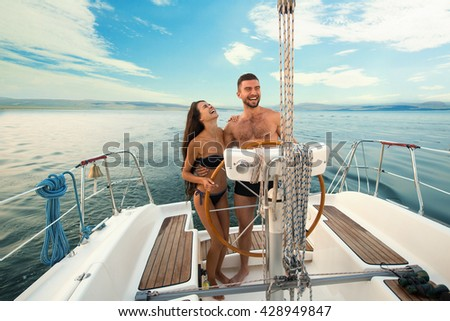 stock photo smiling people at yacht wheel guy with girl on yacht another day in open sea lots of new 428949847