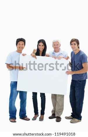 Smiling people holding and showing a big sign against white background - stock photo