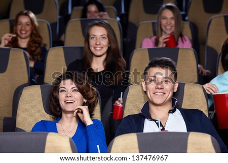 Smiling people in cinema