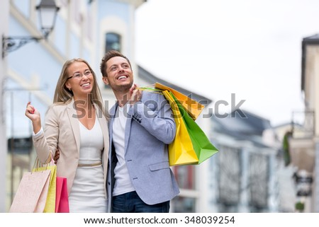 Smiling people with shopping bags - stock photo
