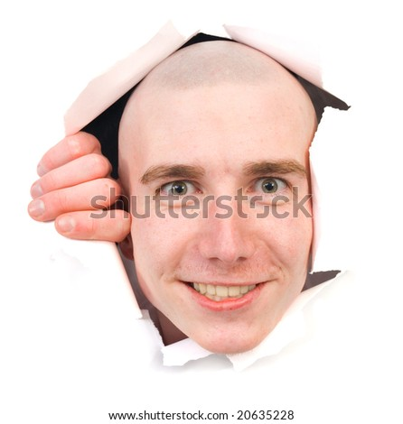 Smiling person young man peering out hole in paper - stock photo