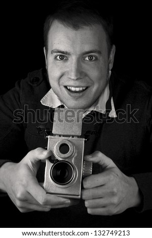 smiling photographer using vintage twin lens reflex tlr camera