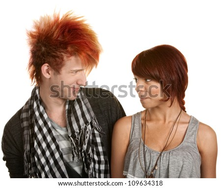 Smiling pierced teen couple looking at each other - stock photo
