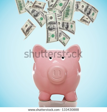 Smiling Piggy bank with hundred dollar bills flowing in or out - stock photo