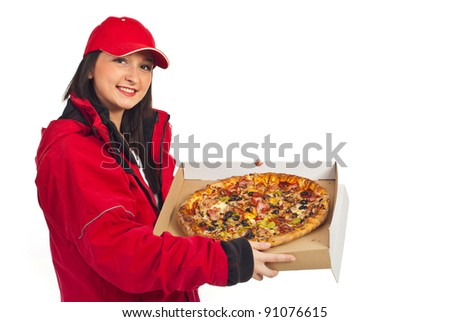 Smiling pizza delivery woman in red cap and coat holding pizza isolated on white background - stock photo