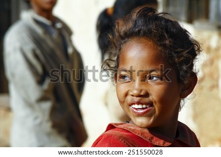 Smiling poor african girl, Madagascar - stock photo