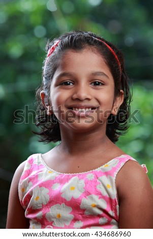Smiling portrait of a girl with outdoor background - stock photo