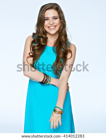 Smiling positive emotional woman standing against white background. Evening dress.