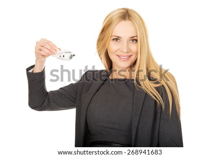 Smiling pregnant businesswoman holding plane model