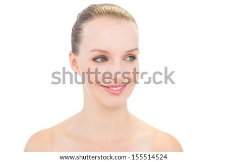 Smiling pretty blonde model posing looking away on white background