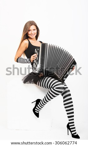Smiling pretty girl playing Russian bayan (button accordion)