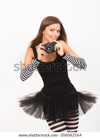 Smiling pretty girl taking a photo - stock photo