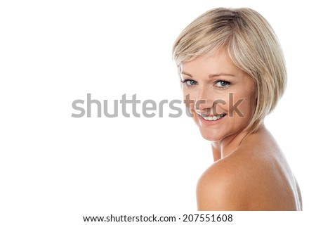 Smiling pretty woman with healthy clean skin - stock photo